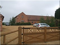 SJ9005 : Brick barns at Lawn Farm by John M