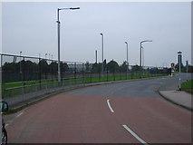 SE5023 : Spawd Bone Lane, Knottingley, with Knottingley High School grounds on the left by Bill Henderson