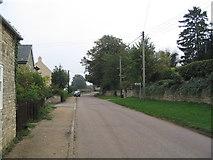 SP9599 : Main street into Wakerley by Tim Heaton
