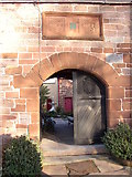 NY6820 : Doorway into St Anne's Hospital, Appleby by Humphrey Bolton