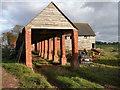 SO6962 : Farm buildings at Burton Court by Philip Halling