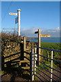SX5747 : Signs and stile near Eastern Lodge by Derek Harper