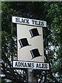 TM2446 : Black Tiles Sign by Keith Evans