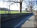 SJ4956 : Bolesworth Road and Footpath by John S Turner