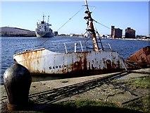 SJ3290 : Jetty with sunken boat by Tom Pennington