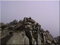 NY2406 : Summit Cairn, Bowfell by Michael Graham
