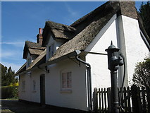 SJ8383 : Thatched Cottage and Water Pump, Styal by Sue Adair