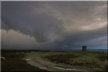 NZ7309 : Danby Beacon with wall cloud by Colin Grice