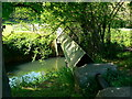 ST7661 : Water-pipe and cover, Midford Brook, Tucking Mill by Brian Robert Marshall
