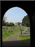 SH5571 : St Tysilio's Cemetery from the door of the church by Eric Jones