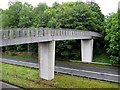 NZ2842 : Footbridge across the A690 by Roger Smith