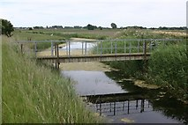 TQ9728 : Footbridge Over Drainage Ditch by Mark Duncan