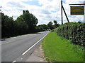 TG2237 : Approach to Roughton on A140 by Evelyn Simak