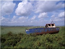 TG0345 : Boat Washed Up from the Cley Channel by Nigel Stickells