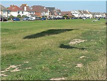 SZ2492 : Barton on Sea: paraglider's shadow on Marine Drive East by Chris Downer