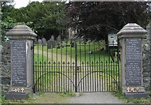 SH5968 : Entrance gates to Eglwys St. Fair by ClockPostcards