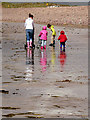 V6491 : Family dressed for the weather by Linda Bailey