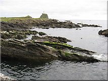 NR7103 : Rocky inlet on south shore of Sanda Island by Frederick Pollock