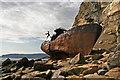 NZ9506 : Wrecked boat by Helen Wilkinson