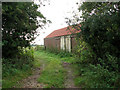 TG4025 : Farm track past barn by Evelyn Simak