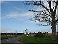 TG4424 : Looking NW on Waxham Road from entrance to Walnut Farm by Evelyn Simak