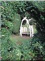 NY2328 : Rustic seat in Mirehouse gardens by Oliver Dixon