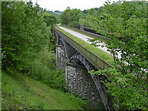 SK1373 : Miller's Dale - south railway viaduct from lime kilns by Dave Bevis