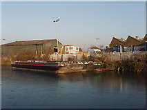 TQ2182 : Wide dumb  barges on the frozen Grand Union Canal by David Hawgood