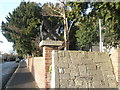 SU6805 : St Andrew's Cross on Church Gatepost by Basher Eyre