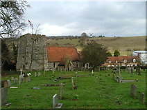 SU7691 : St Mary's Church, Turville with the windmill on the hill by Peter Jemmett