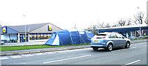 SH5638 : Lidl and Outdoor World stores seen across the Penamser Road by Eric Jones