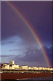 TQ3103 : Rainbow over Brighton Beach and seafront from Brighton Pier, East Sussex by Christine Matthews