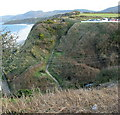 SH2840 : View east across Lon Bridin/Beach Road towards the cliff top path to Nefyn by Eric Jones