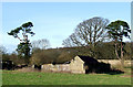 SO5188 : Derelict Barns north of Munslow, Shropshire by Roger  Kidd
