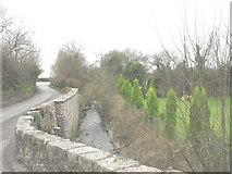 SH3537 : Afon Rhyd-hir a minor road and an ornamental garden by Eric Jones