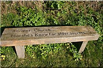 TM3898 : Seat at entrance to churchyard by Bill Sibley