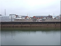 SX9291 : Quayside piling, Exeter, with reduced flow by David Smith