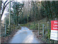 SN6579 : The track to Rhiwarthen crossing the Vale of Rheidol Railway by John Lucas