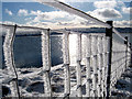 SH8319 : Llyn Y Fign with ice fence by Dave Croker