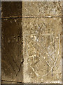 TG2532 : St Mary's church - graffiti on south doorway by Evelyn Simak