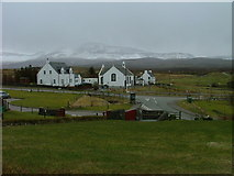 NG4867 : Church and Houses at Staffin by Dave Fergusson