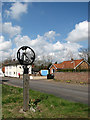 TG1022 : Booton village sign by Evelyn Simak