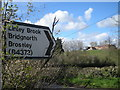 SO6797 : Road sign and Bank Farm by Row17