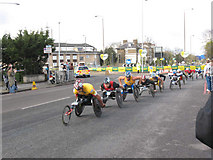 TQ4077 : London Marathon at Shooters Hill - wheelchairs by Stephen Craven