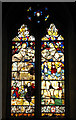 TG0704 : St Peter's church - medieval stained glass by Evelyn Simak