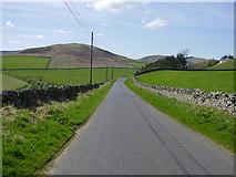 NT4437 : Road through Borders farmland by James Denham