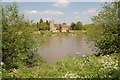 SO7716 : Minsterworth church from across the Severn at Elmore Back by Roger Davies