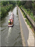 TQ2783 : Regent's canal with passenger boat and jogger by David Hawgood