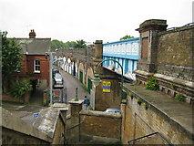 TQ2475 : Putney: Deodar Road railway bridge and arches by Nigel Cox