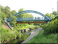 TQ3672 : Pipe bridge over the River Pool by Stephen Craven